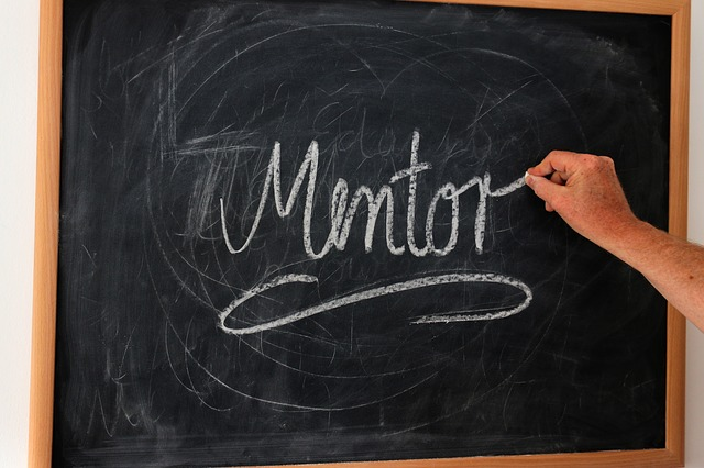 A chalkboard with the word mentor written on it in chalk. The article is about how to get a mentor.